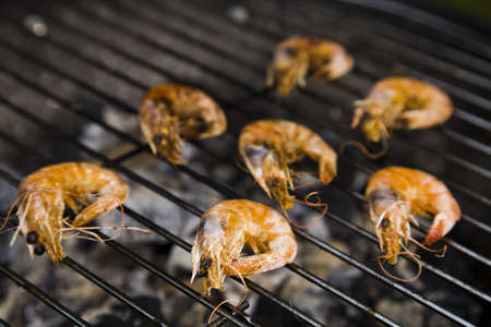 barbequing: Grilling fish and shrimps  Tasty dinner