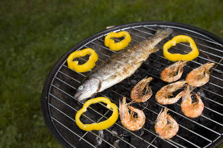 Grilling fish and shrimps  Tasty dinner photo