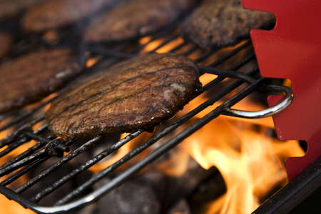 barbequing:  Closeup of fried burgers