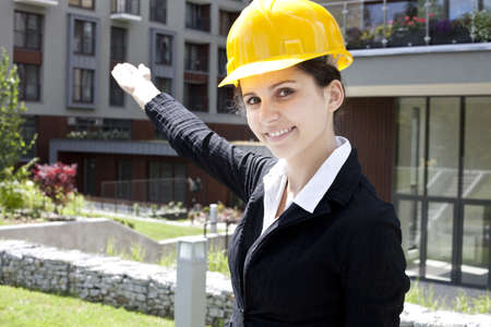 Female construction engineer show building in background Stock Photo - 14587719
