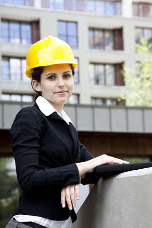 Female construction engineer and yellow helmet photo