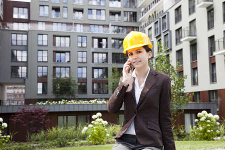 Female construction engineer and yellow helmet Stock Photo - 14587653