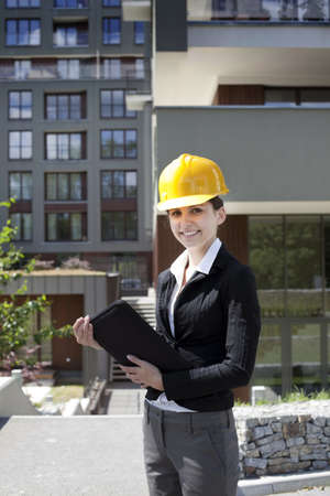 female construction worker: Female construction engineer and yellow helmet