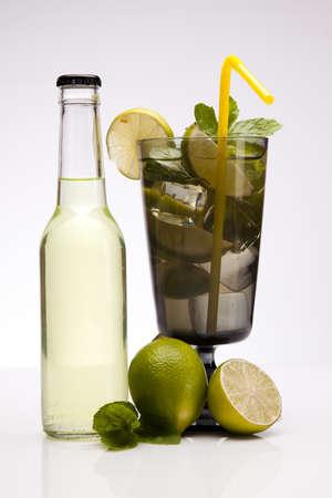 Exotic bottle alcohol cocktail isolated on white photo