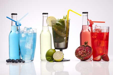 Exotic alcohol drinks set with fruits isolated on white background photo