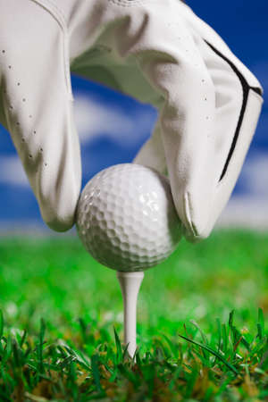 golf field: Golf ball on the green grass  Studio Shot  Stock Photo