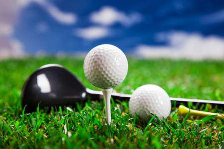 Golf ball on the green grass. Studio Shot! photo