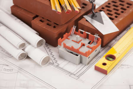 Building and construction equipment on blueprints photo