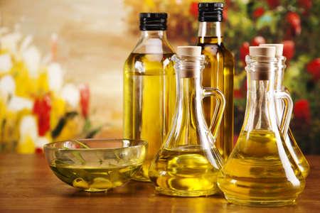 Fresh olives, olive oil on olive wood  Extra virgin Standard-Bild