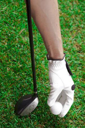 Golf ball on the green grass  Studio Shot  photo