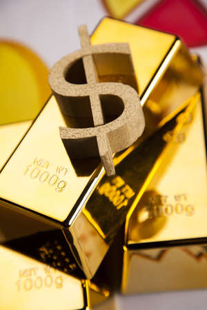Gold bars on colorful diagrams  photo