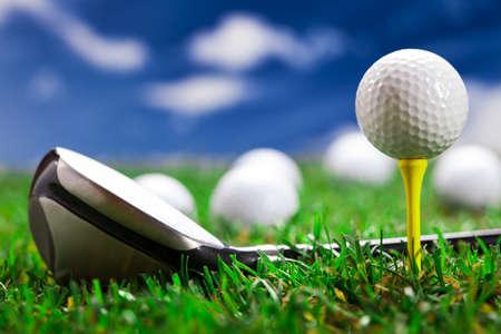 golf clubs: Golf ball on the green grass. Studio Shot!