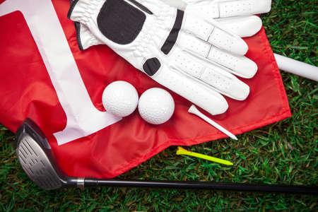golf glove: Golf ball on the green grass. Studio Shot!