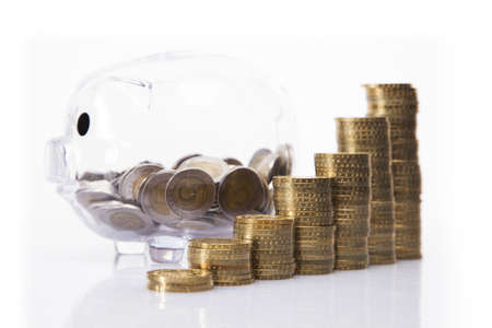 retirement money: Savings in piggy bank  A lot of money  Isolated on white background  Stock Photo