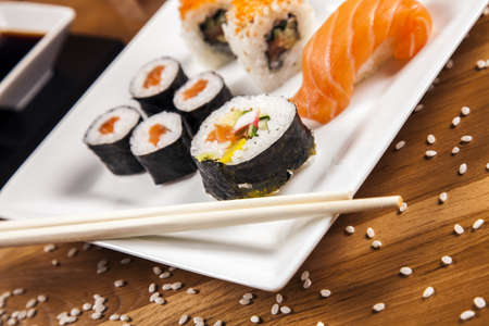 Variation of fresh tasty sushi food photo
