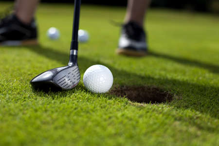 Closeup of hole on golf field photo