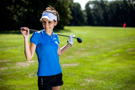 Portrait of a woman playing golf in summer photo