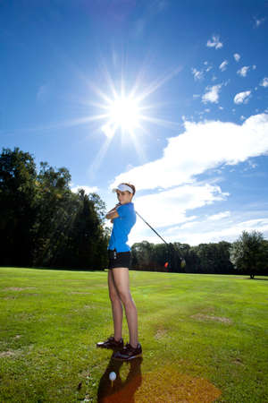 Pretty Woman playing golf on field photo