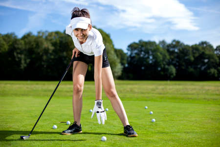 woman golf: Pretty girl playing golf on grass in summer
