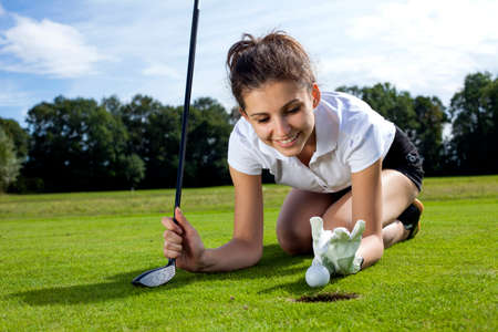 tried: Pretty girl cheating on golf field, tried to push the ball with her finger