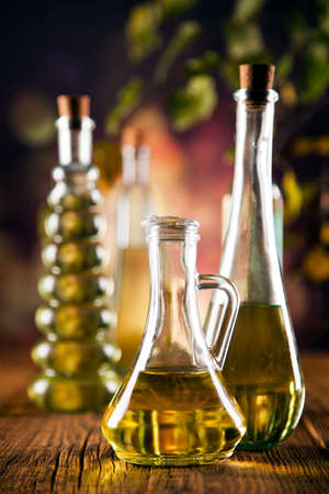 Olive oil in bottles. Composition on wooden table. Studio shot photo