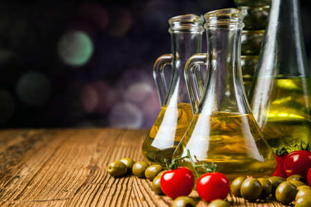 Composition of olive oils in bottles with ingriedients photo