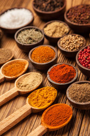 Spices and herbs in wooden bowls  Food and cuisine ingredients  photo