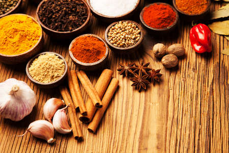 flavoring: Spices and herbs in wooden bowls  Food and cuisine ingredients