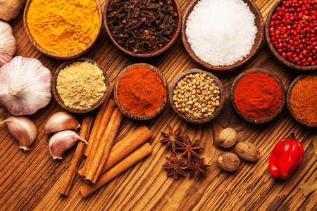 spice market: Spices and herbs in wooden bowls  Food and cuisine ingredients