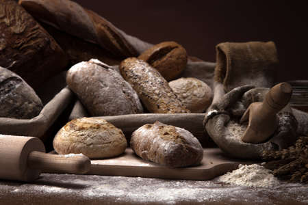 breadloaf: Fresh bread and wheat on the wooden table