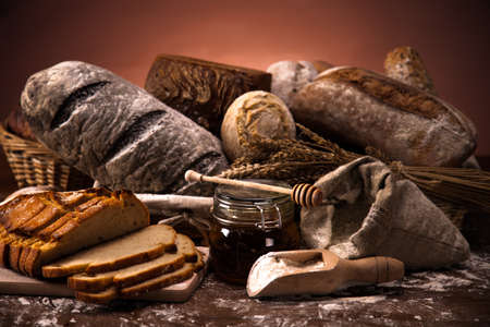 Fresh bread and wheat on the wooden table photo