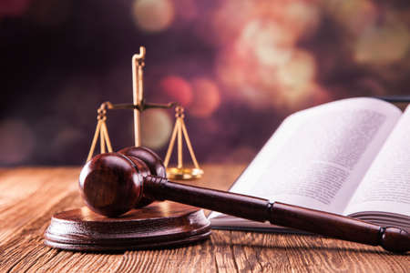 Law code, gavel and books