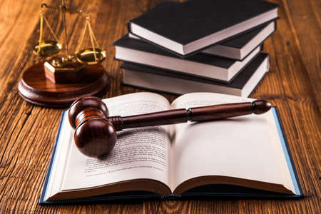 Law code, gavel and books  photo