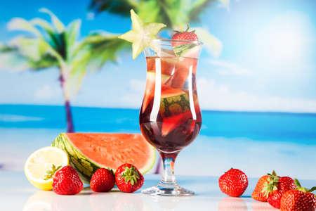 Tropical drinks on beach and sun