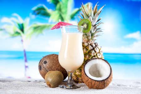 Tropical drinks on beach and sun photo