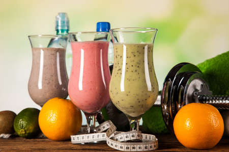 Healthy diet, protein shakes, fruits and sport and fitness concept