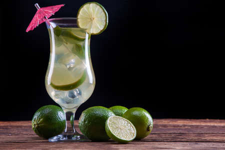 Mojito drink ob black background with fruits photo