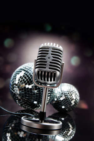 Professional silver microphone on a black glossy background photo