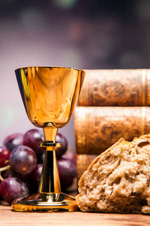 Sacred objects, bible, bread and wine. photo