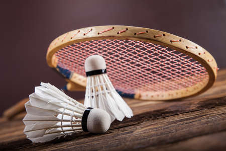 badminton racket: A set of badminton. Paddle and the shuttlecock. Studio shot Stock Photo