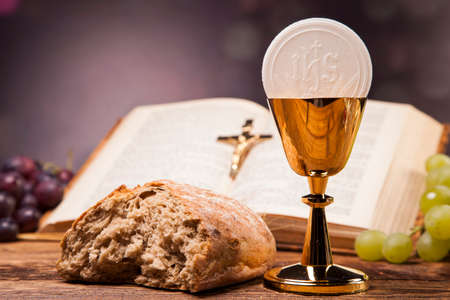 holy bible: Sacred objects, bible, bread and wine. Stock Photo