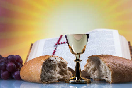 holy bible: Christian religion, wine, bread and the word of God on yellow background