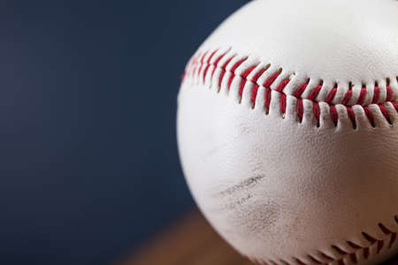 pitchers mound: Baseball ball on wooden table and blue backgdound Stock Photo