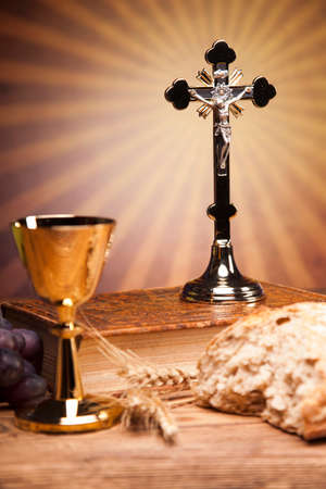 first holy communion: Sacred objects, bible, bread and wine. Stock Photo