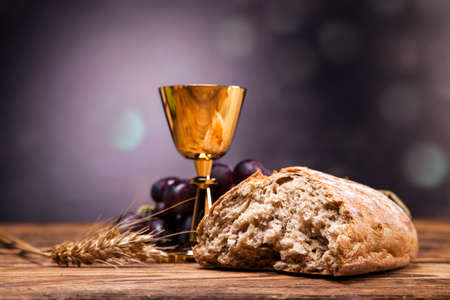 jesus praying: Sacred objects, bible, bread and wine. Stock Photo