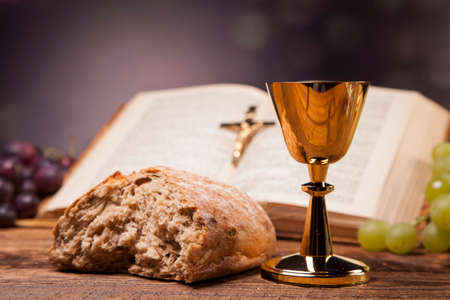 communion wafer: Sacred objects, bible, bread and wine. Stock Photo