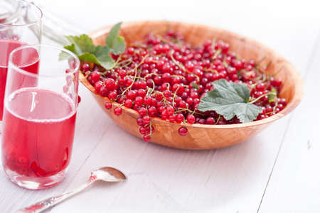 red currant: Healthy red currants in a bowl with extras. Studio Shot