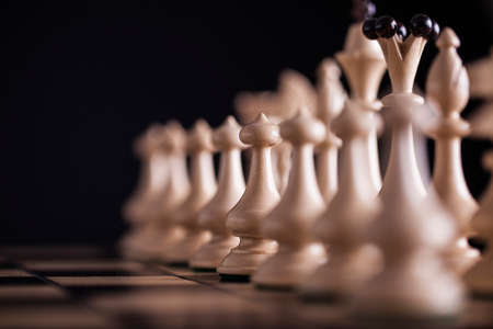 pawns: Chess. White pawns vs black on wooden chessboard