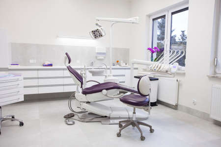 dentist drill: Modern dental practice. Dental chair and other accessories used by dentists.