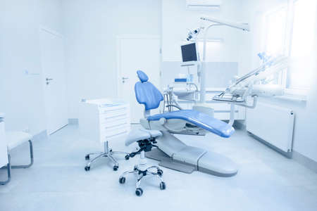 Modern dental practice. Dental chair and other accessories used by dentists.